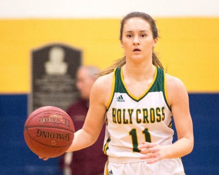 Holy Cross' Hannah Brown (11) brings the ball up court during their NVL semi-final game against Watertown Monday at Kennedy High School in Waterbury. Brown scored 12 in their 48-32 win over the Indians. Jim Shannon Republican American