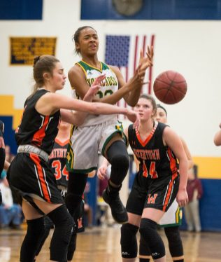 Holy Cross' Cayla Howard (23) has the ball knocked away by Watertown's Cayla D'Elia (1) while driving to the basket during their NVL semi-final game Monday at Kennedy High School in Waterbury. Jim Shannon Republican American