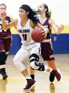 #11 Janessa Gonzalez of St. Paul drives to the hoop against Naugatuck High during the NVL semi final at Kennedy High in Waterbury Monday. Steven Valenti Republican-American