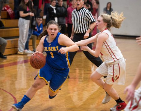 Gilbert's Jillian Wexler (1) drives to the basket while being defended by Northwestern's Skylar Dimartino (11) during their Berkshire League semi-final game Tuesday at Northwestern Regional High School in Winsted. Jim Shannon Republican American
