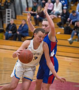 Housatonic's Sydney Segalla (13) drives to the basket while being defended by Nonnewaug's Maddie Woodward (34) during their Berkshire League semi-final game Tuesday at Northwestern Regional High School in Winsted. Jim Shannon Republican American