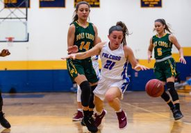 St Paul's Catherine Ciampi #21 gets inadvertently bumped off the ball by Holy Cross' Maeve Perrone #14, during the NVL girls basketball final between Holy Cross and St Paul at Kennedy High School in Waterbury on Thursday. St Paul went on to win pulling away very late 57-51 and winning the NVL Conference Championship. Bill Shettle Republican-American.