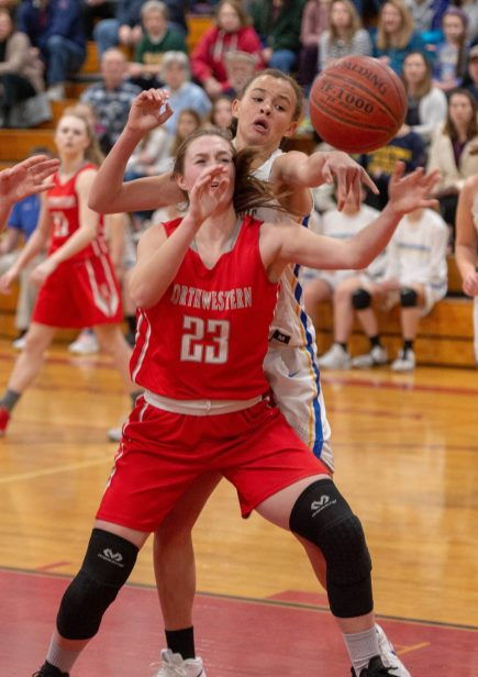 Northwestern's (23) has a pass knocked away by Housatonic's Sydney Segalla (13) during the Berkshire League tournament finals Friday at Northwestern Regional High School in Winsted. Jim Shannon Republican American