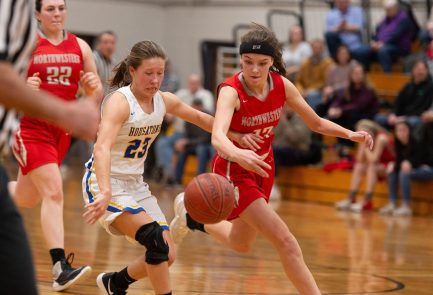 Housatonic's Christina Winburn (23) and Northwestern's Emma Propfe (13) run down the ball after Propfe knocked it away during their Berkshire League tournament finals game Friday at Northwestern Regional High School in Winsted. Jim Shannon Republican American