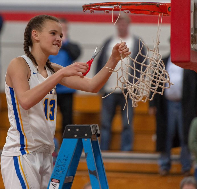 Housatonic's Sydney Segalla (12) helps to cuts down the net following their win over Northwestern to capture the Berkshire League tournament title Friday at Northwestern Regional High School in Winsted. Jim Shannon Republican American