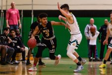 WCA's Langston Racine tries to dribble around Holy Cross' Kyle Lombardi #23, during the boys NVL Conference Tournament between WCA and Holy Cross at Wilby High School in Waterbury on Saturday. Bill Shettle Republican-American