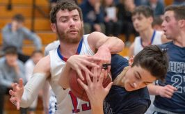 Nonnewaug's Jarrett Michaels (13) and Shepaug's Michael Perachi (1) battle for a rebound during their Berkshire League tournament game Tuesday at Lewis Mills High School in Burlington. Jim Shannon Republican American