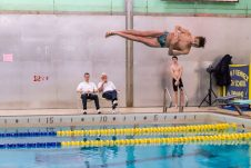 Marcas Racevicius of Holy Cross completes a full twist before entering the water, as he completes his tenth dive during the 2019 NVL Diving Championships at Kennedy High School in Waterbury on Wednesday. Marcas came in second overall in the NVL Championships. Bill Shettle Republican-American