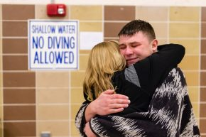 Riley Clark of Woodland and his mom Michelle embrace in celebration after he won the 2019 NVL Diving Championships at Kennedy High School in Waterbury on Wednesday. Bill Shettle Republican-American