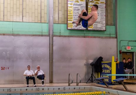 Riley Clark of Woodland gets into a tuck position as he completes a dive, during the NVL Diving Championships at Kennedy High School in Waterbury on Wednesday. Riley Clark came in first and won the 2019 NVL Diving Championships. Bill Shettle Republican-American