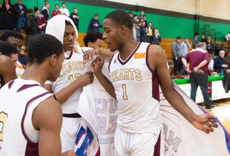 Sacred Heart's Nate Tabor (1) Omar Rowe (13) and Lorenzo Washington (2) celebrate their win over Torrington to capture the NVL tournament championship Wednesday at Wilby High School in Waterbury. Jim Shannon Republican American