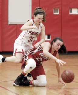 Pomperaug's Madison Villa (35) Branford's Karly King (24) for the ball during the second round of the Class L tournament Thursday night at Pomperaug High School. Pomperaug defeated Branford 60-44. Michael Kabelka / Republican-American.