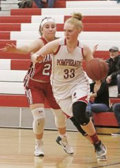 Pomperaug's Maggie Lee (33) moves the ball as Branford's Gabriella Lucertini (23) defends during the second round of the Class L tournament Thursday night at Pomperaug High School. Pomperaug defeated Branford 60-44. Michael Kabelka / Republican-American.