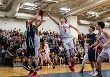 Wamogo's Sean Coffey #3 blocks the shot of Shepaug's Ethan Hibbard #33 down low, during the BL Conference Tournament Championship game between Shepaug and Wamogo at Lewis Mills High School in Burlington on Friday. Wamogo wins the BL Conference Championship after defeating Shepaug 74-47. Bill Shettle Republican-American
