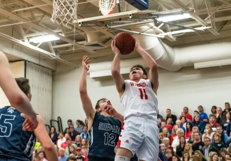 Wamogo's Ethan Collins #11 goes up for a shot against Shepaug's Jack Schneider #12, during the BL Conference Tournament Championship game between Shepaug and Wamogo at Lewis Mills High School in Burlington on Friday. Wamogo wins the BL Conference Championship after defeating Shepaug 74-47. Bill Shettle Republican-American