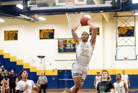 WCA's Marquan Watson (22) slams in two of this points during their 44-39 win over Enfield in their Division II first round game Tuesday at Kennedy High School in Waterbury . Jim Shannon Republican American