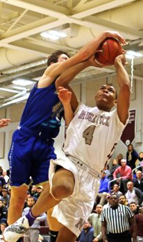 Naugatuck's Avery Hinnant (4) draws a foul from Newtown's Jacksen Peterson (44) during the opening round of division III boys basketball tournament at Naugatuck High School Thursday night. Naugy defeated Newtown to advance. Michael Kabelka / Republican-American