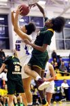#42 Jade Udoh of St. Paul Catholic gets fouled by #15 Iyanna Lops of Trinity Catholic while going up for a shot during the CIAC Class S semi final in Newtown Friday. Steven Valenti Republican-American