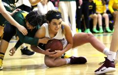#22 Morgan Kolb of St. Paul Catholic battles for the loose ball with #13 Caitlyn Scott of Trinity Catholic during the CIAC Class S semi final in Newtown Friday. Steven Valenti Republican-American