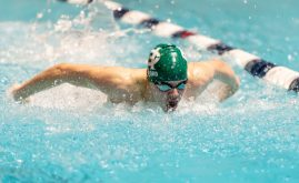 Holy Cross' Alex Ford competes in the 100 butterfly during the State Open swim championships Thursday at Yale University. Jim Shannon Republican American