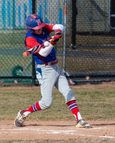 Nonnewaug's Joe Rupe (6) makes contact during his time at the plate during their scrimmage with Wilby Monday at Nonnewaug High School in Woodbury. Jim Shannon Republican American