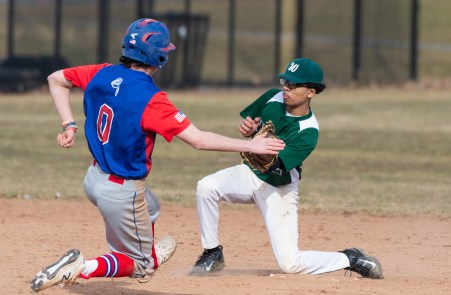 Wilby's Frandy Espinal (2) tags out Nonnewaug's Hayden Brochu (0) as he tries to steal second base during their scrimmage Monday at Nonnewaug High School in Woodbury. Jim Shannon Republican American