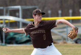 Thomaston's Andrew Colavecchio (1) delivers a pitch during their non-league game with Sacred Heart Saturday at Thomaston High School. Jim Shannon Republican American