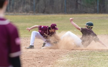 Thomaston's Thomaston's Andrew Colavecchio (1) is tagged out by Sacred Heart's Ryan Bethin (11) as he tries to steal second base during their non-league game Saturday at Thomaston High School. Jim Shannon Republican American