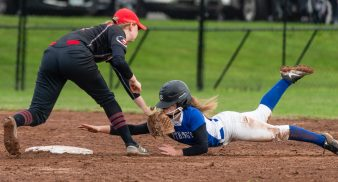 Cheshire's Mia Juodiatis (4) tags out Southington's Kayla Pelletier (5) after she over shot second base on a steal attempt during their game Tuesday at Cheshire High School. Jim Shannon Republican American