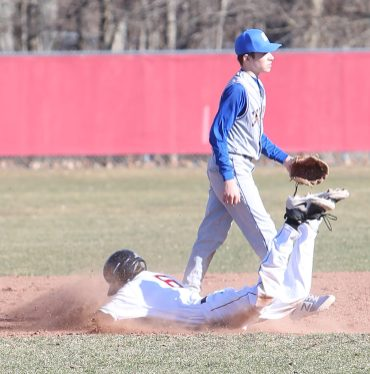 Pomperaug High School's Dean Koulouris slides head first into second base during the opening day boys varsity baseball game against Seymour High School in Southbury on Monday, April 1, 2019. Emily J. Reynolds. Republican-American