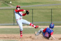#1 Levi Delaney of Northwestern Regional High makes the throw to first for the double play as #20 Mitch Abramovich of Nonnewaug High slides out during baseball action in Woodbury Monday. Steven Valenti Republican-American