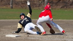 WCA's William Carillo (20) slides safely into third before the tag by Wolcott's Trey Nastri (32) during their game Tuesday at Washington Park in Waterbury. made his way to third from first base on a base hit by Jacob Torres (2) in their 1-0 win over the Eagles. Jim Shannon Republican American