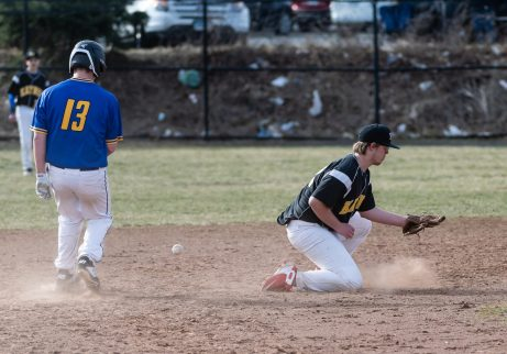 Kaynor Tech's Thomas Donston can't handle the throw to him as Wilcox Tech's James Theriault gets back to second base, during a CTC league Baseball game between Wilcox Tech and Kaynor Tech at Kaynor Tech in Waterbury on Thursday. Bill Shettle Republican-American