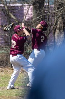 Sacred Heart's Vin Santopietro (12) and Justin Stephens (2) collide while both going for a fly ball during their game against Notre Dame-Fairfield Saturday at Waterville Park in Waterbury. Jim Shannon Republican American