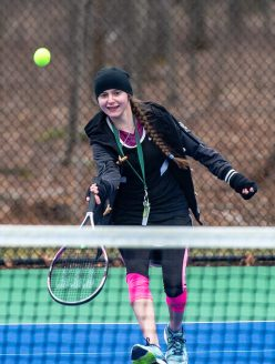 Thomaston's Kestrel Wilcox runs down a shot during her match with Housatonic's Abby Larson Tuesday at Nystrom's Sports Complex in Thomaston. Jim Shannon Republican American