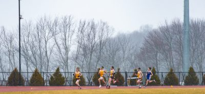 Thomaston and Housatonic runners circle the track in the rain and fog while competing in the 800 meter run during their Berkshire League meet Tuesday at Nystrom's Sports Complex in Thomaston. Jim Shannon Republican American