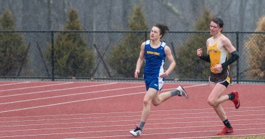 Housatonic's Liam Money overtakes Thomaston's Jack McMahon to take second place in the 800 meter run during their Berkshire League meet with Tuesday at Nystrom's Sports Complex in Thomaston. Jim Shannon Republican American