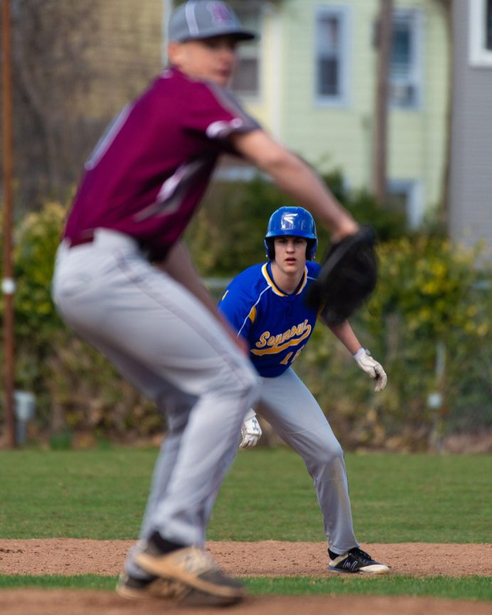 Seymour's Dan Manente (15) looks on from second base as Naugatuck's Nate Deptula goes into his wind up during their game Wednesday at French Memorial Park in Seymour. Jim Shannon Republican American