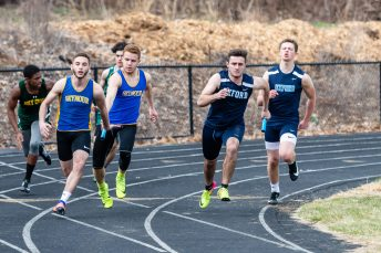 Seymour's Tyler Ganim gives the baton to his teammate Kyle Gabianelli, left, as Oxford's Ethan Stella-Mackie gives the baton to his teammate Drew Adames, for the final leg of the boys 4 x 100 relay, during a a NVL Track and Field meet between Holy Cross, Oxford, and Seymour at Holy Cross High School in Waterbury on Friday. Bill Shettle Republican-American