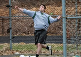 Holy Cross' James Lanese throws the discus 106', two feet off his best, during a a NVL Track and Field meet between Holy Cross, Oxford, and Seymour at Holy Cross High School in Waterbury on Friday. James came in third in the discus competition. Bill Shettle Republican-American