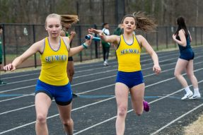Seymour's JennaFette, right, gives the baton off to her teammate Maya Pekarek, left, in the final leg of the Girls 4 x 100 relay, during a a NVL Track and Field meet between Holy Cross, Oxford, and Seymour at Holy Cross High School in Waterbury on Friday. Bill Shettle Republican-American