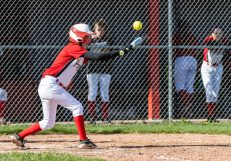 Pomperaug's Amanda Rinaldi #0 attempts to bunt the ball to move the runners over, during a Girls SWC Softball game between Newtown and Pomperaug at Pomperaug High School in Southbury on Wednesday. Bill Shettle Republican-American