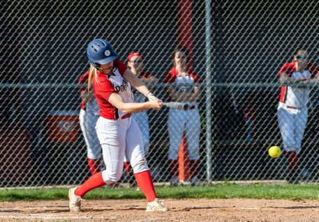 Pomperaug's Rachael Ushka #12 hits for an rbi double, during a Girls SWC Softball game between Newtown and Pomperaug at Pomperaug High School in Southbury on Wednesday. Bill Shettle Republican-American