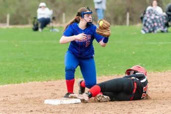 Nonnewaug's Brianna Hynds #5 shows the ump she has the ball after tagging out Wamogo's McKenzie Hoyt #17, trying to slide into second, during a Girls BL Softball game between Wamogo and Nonnewag at Nonnewaug High School in Woodbury on Thursday. Bill Shettle Republican-American