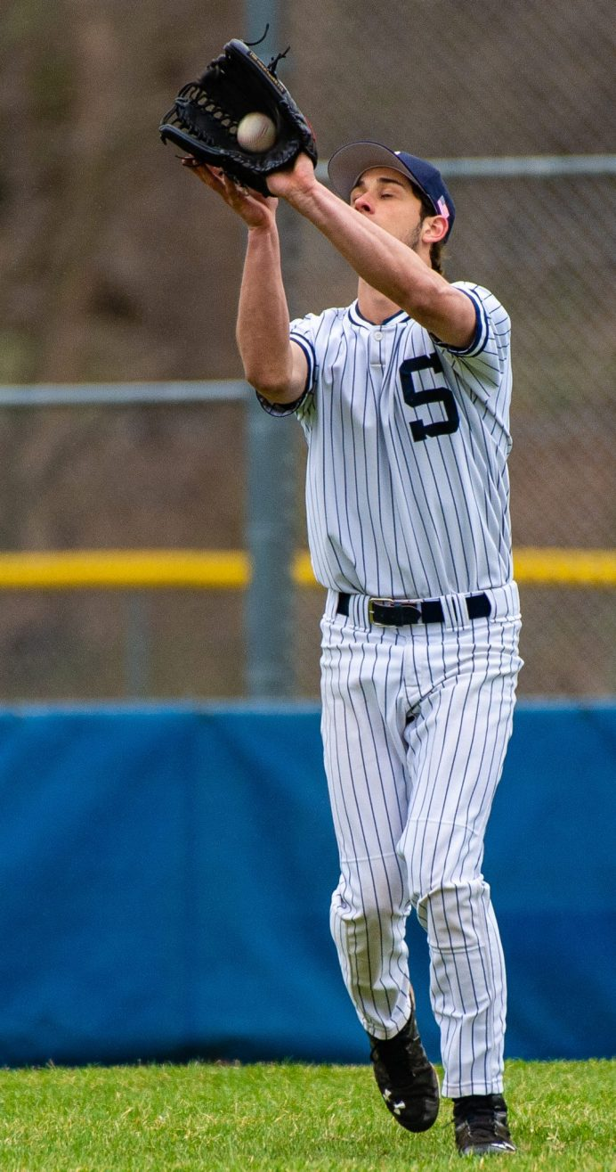 Shepaug's Jack Pesce (28) pulls in a fly ball during their game against Northwestern Thursday at Tex Alex Field in Washington. Jim Shannon Republican American