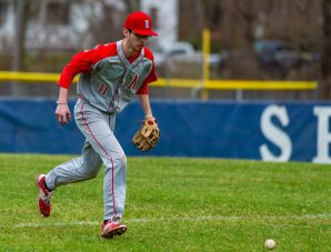 Northwestern's Noah McDonald (11) runs shown the ball hit to the outfield for a base hit during their game Thursday against Shepaug at Tex Alex Field in Washington. Jim Shannon Republican American