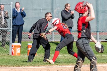 Wamogo's Savannah Wheeler #20, center slaps hands with her coach Dave Silvester, left, celebrating her two run homer, during a Girls BL Softball game between Northwestern and Wamogo at Wamogo High School in Litchfield on Wednesday. Northwestern beat their rival Wamogo 9-5. Bill Shettle Republican-American