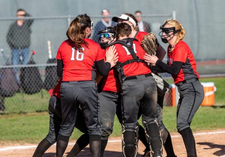 Northwestern teammates celebrate with Riley Webb 320, second from left, after her game ending double play, during a Girls BL Softball game between Northwestern and Wamogo at Wamogo High School in Litchfield on Wednesday. Northwestern beat their rival Wamogo 9-5. Bill Shettle Republican-American