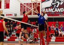 Lewis Mill's Sam DiSorbo #12, right tries to tip the ball over the hands of Cheshire's Colby Hayes #25, during a boys volleyball match between Lewis Mills and Cheshire at Cheshire High School in Cheshire on Friday. Bill Shettle Republican-American