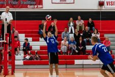 Lewis Mills' Sam Di Sorbo #12 gets ready to set up his teammate Josh Schibi #27, for a spike, during a boys volleyball match between Lewis Mills and Cheshire at Cheshire High School in Cheshire on Friday. Bill Shettle Republican-American